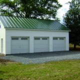 24x36 Two Story Vinyl Garage with Standing Seam Metal Roof